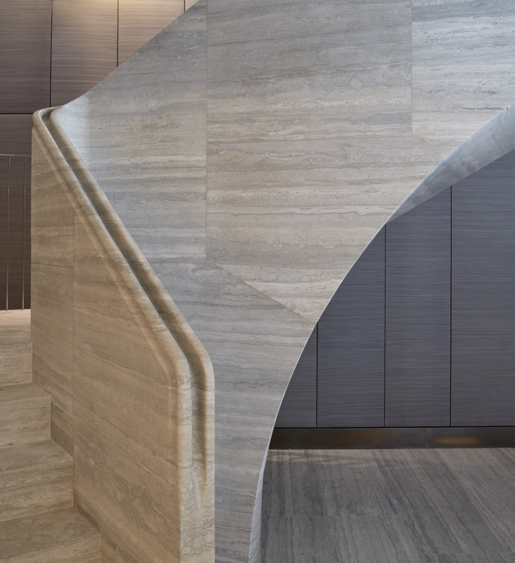 Jamie-Fobert-Architects- Travertine-stair-central-London-duplex-luxury-apartment- elegant-stone-handrail